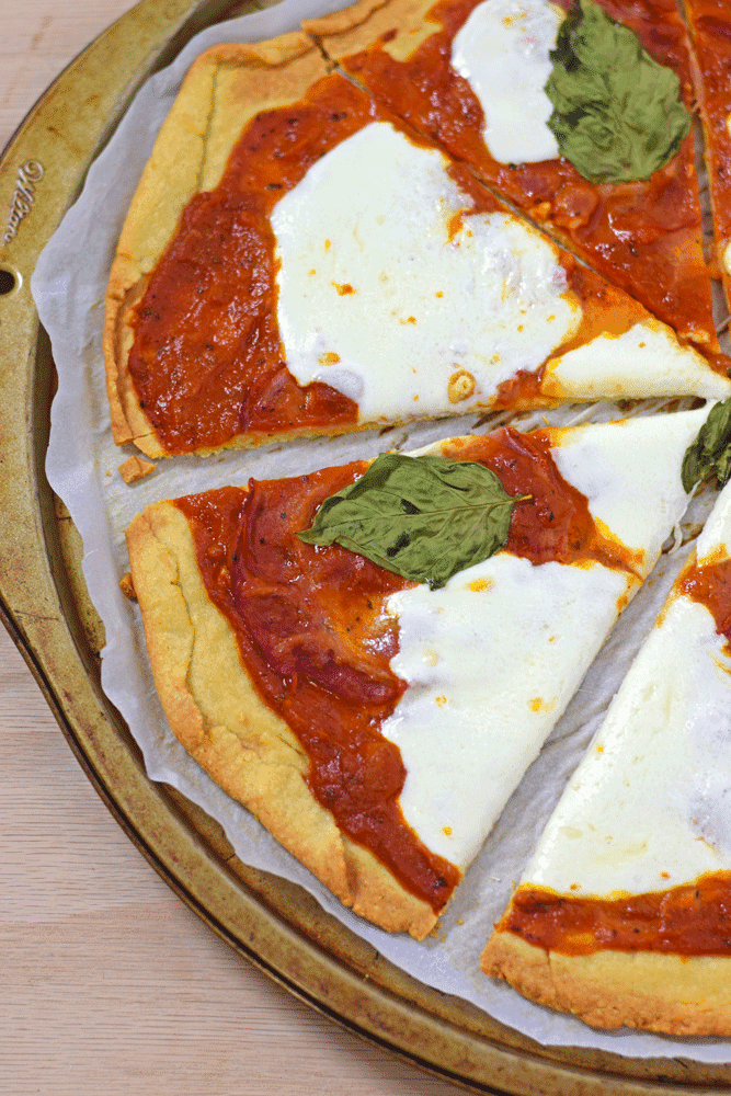 """Gluten Free Pizza Crust - Made with almond and potato flour, this Gluten Free Pizza Crust is one of my favorites. It's a nice thin crust that isn't overly """"rice-y"""" like many gluten free mixes. // isabeleats.com"""