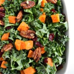 Roasted Sweet Potato & Kale Salad with Candied Pecans & Cranberries | fromcatstocooking.com