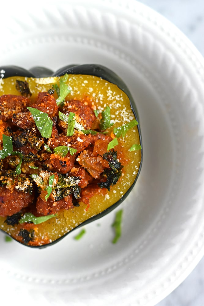 A deliciously simple and seasonal Sausage, Onion & Kale Stuffed Acorn Squash recipe that's perfect for the cold months of winter. // isabeleats.com