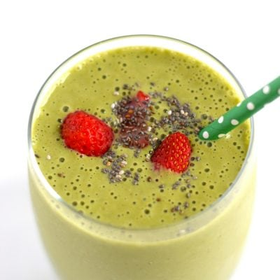 Strawberry Mango Green Smoothie - An easy, quick and tasty on-the-go breakfast smoothie or post-workout drink filled with fruit, greens and greek yogurt. Can easily be dairy free! - fromcatstocooking.com
