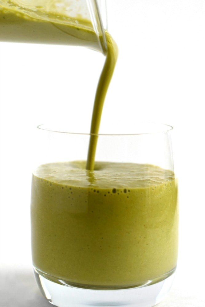 Strawberry Mango Green Smoothie - An easy, quick and tasty on-the-go breakfast smoothie or post-workout drink filled with fruit, greens and greek yogurt. Can easily be dairy free! - isabeleats.com