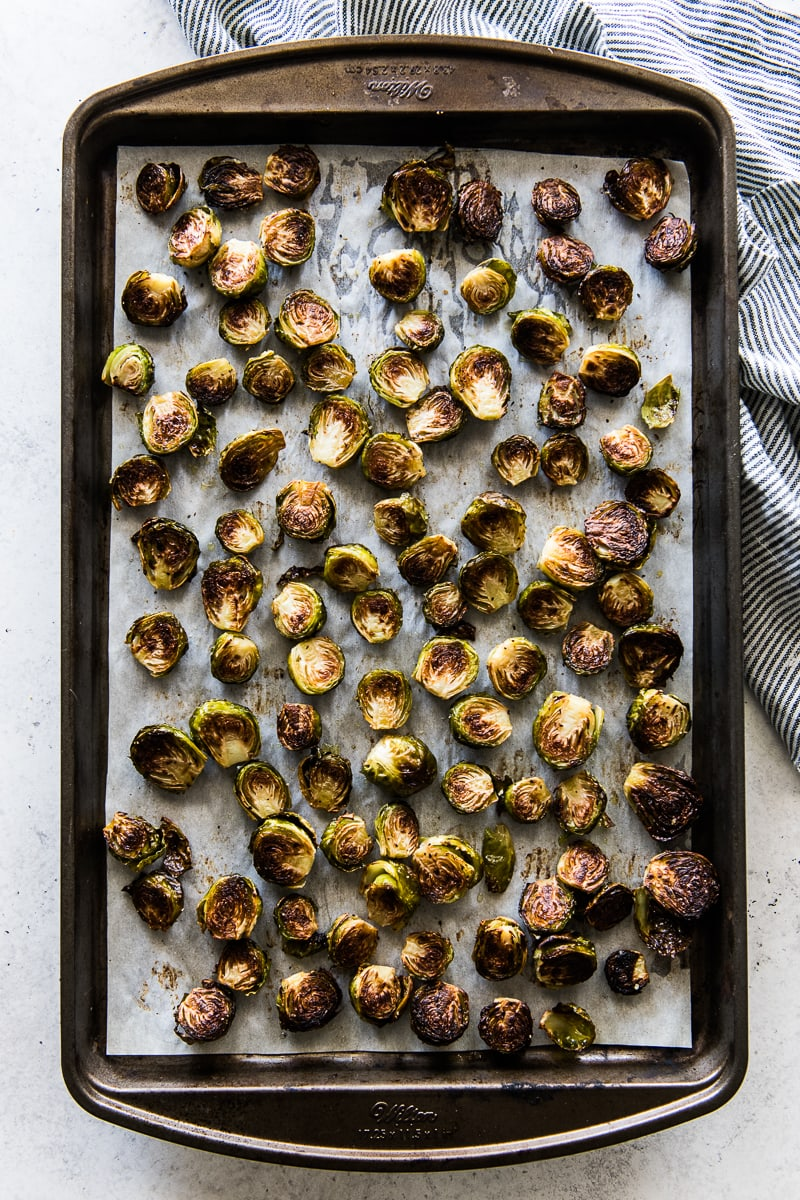 Roasted honey balsamic brussel sprouts on a baking sheet.