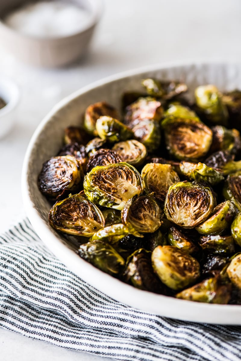 Honey balsamic brussel sprouts in a white bowl ready to be served.