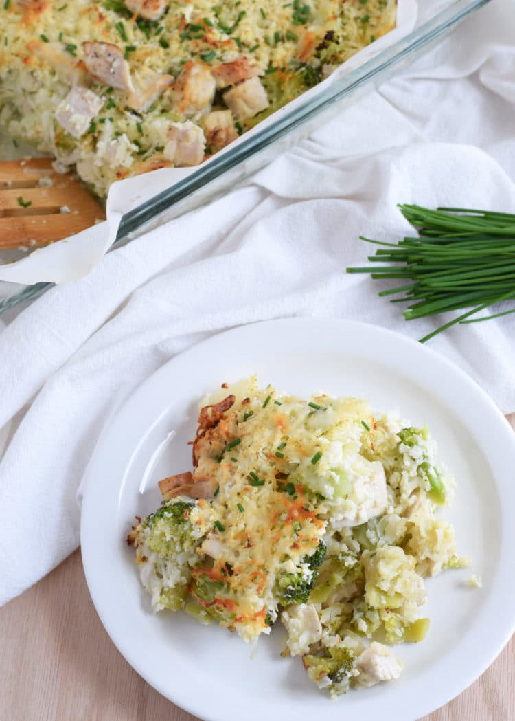 A healthy and cheesy broccoli and cauliflower rice chicken casserole that is perfect for dinner and makes great leftovers. Gluten free and grain free! // isabeleats.com