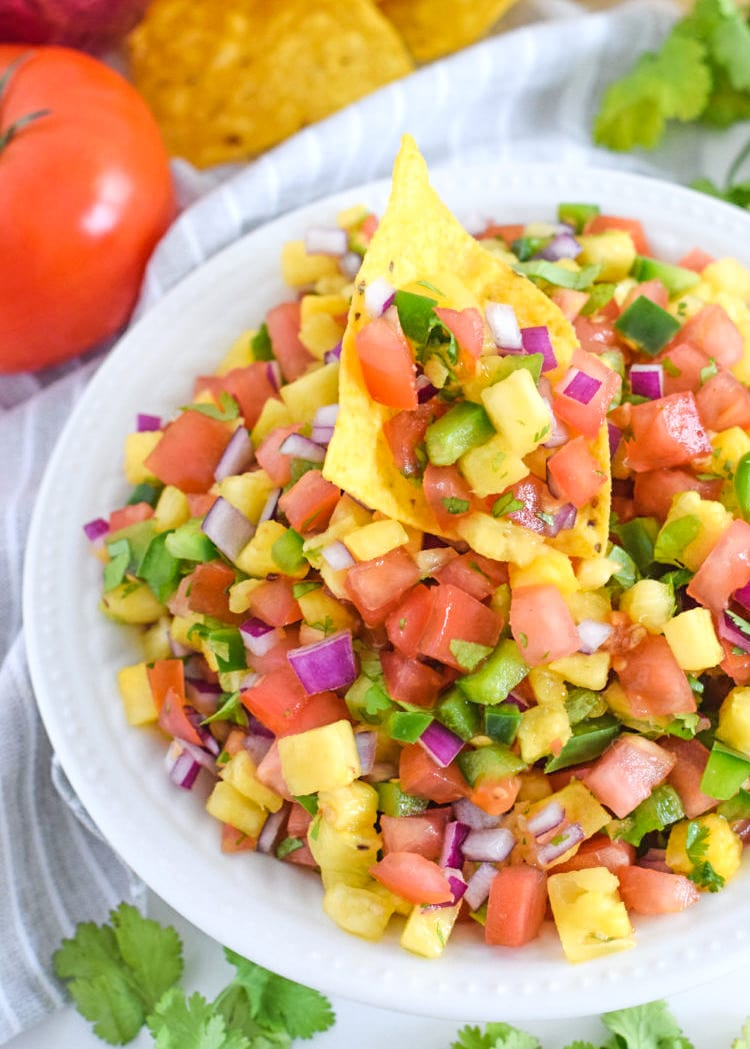 This Pineapple Salsa recipe only requires 6 ingredients and 15 minutes to make. It's the perfect appetizer to serve with tortilla chips and is delicious on tacos and grilled meat!