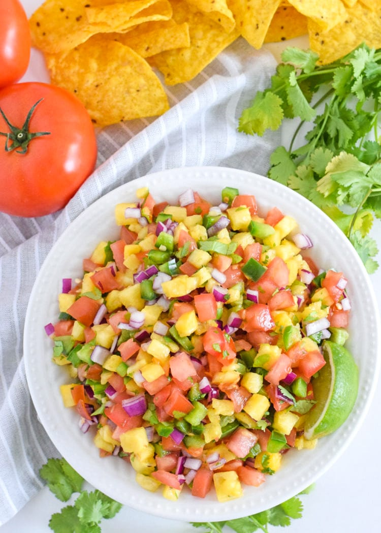 This Pineapple Salsa only requires 6 ingredients and 15 minutes to make. It's the perfect appetizer to serve with tortilla chips and is delicious on tacos and grilled meat!