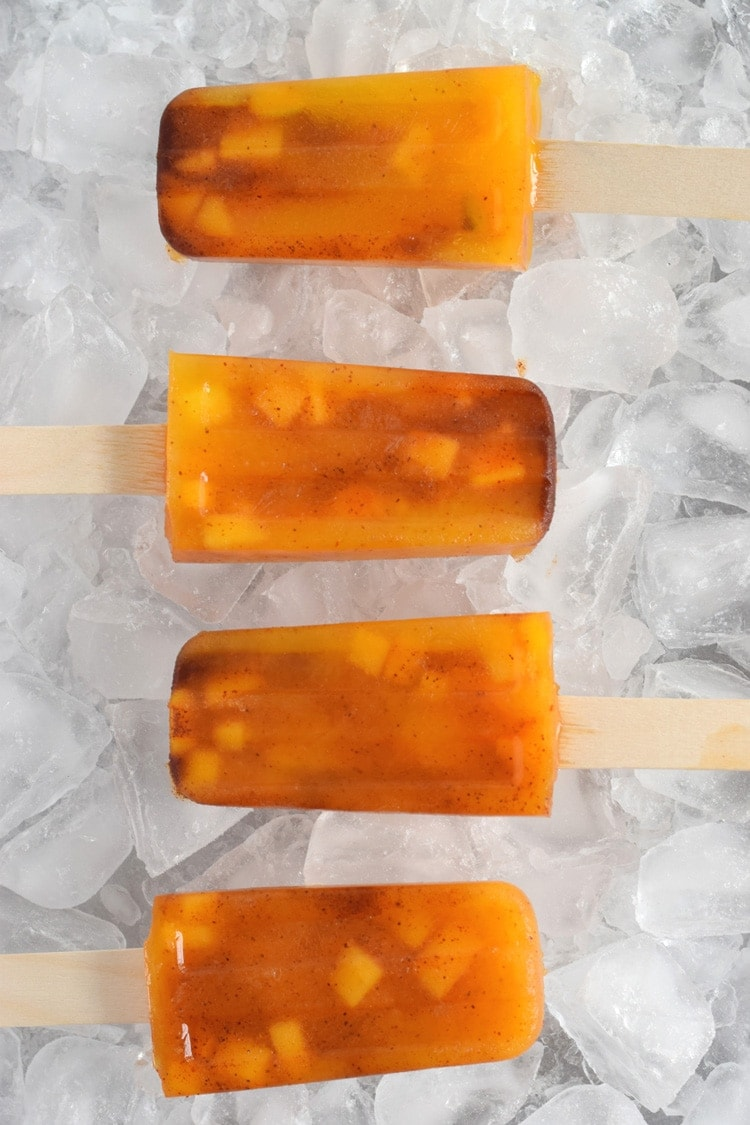 This easy to make Mexican-inspired Mango Chili Popsicle recipe is made with only 4 ingredients and makes a perfect healthy afternoon snack or dessert for those hot summer days.