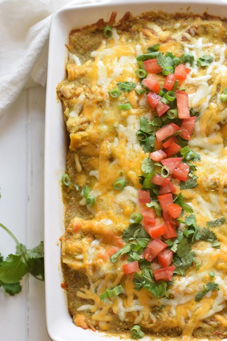 Covered in an easy Homemade Tomatillo Salsa Verde, these baked Mexican Salsa Verde Chicken Enchiladas are great for dinner and make tasty leftovers that everyone will be excited to eat. It's one of my favorite recipes and is also gluten free!