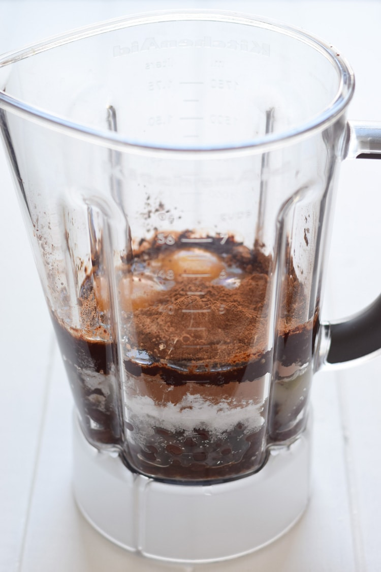A blender full of ingredients for black bean brownies