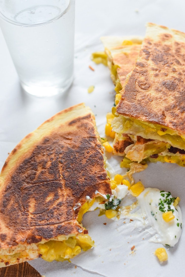 These Easy Green Chile & Corn Quesadillas take only 12 minutes to make, are an easy lunch or dinner option and are vegetarian friendly! Plus, they're also an inexpensive meal. All you need are some flour tortillas, canned corn, canned diced green chiles and shredded cheese!