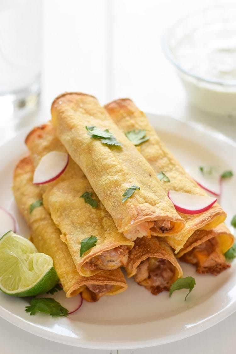 If you're looking for an easy, freezer-friendly meal, look no further than these Baked Chicken, Bean & Cheese Taquitos. Loaded with mashed pinto beans, shredded Mexican cheese and chili-spiced baked chicken, these taquitos are just like your favorite tacos, but even more fun to eat!
