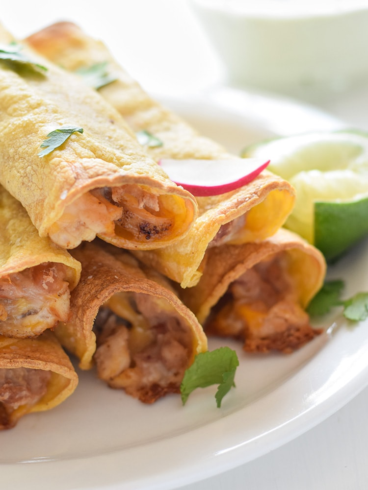 ... shredded Mexican cheese and chili-spiced baked chicken, these taquitos