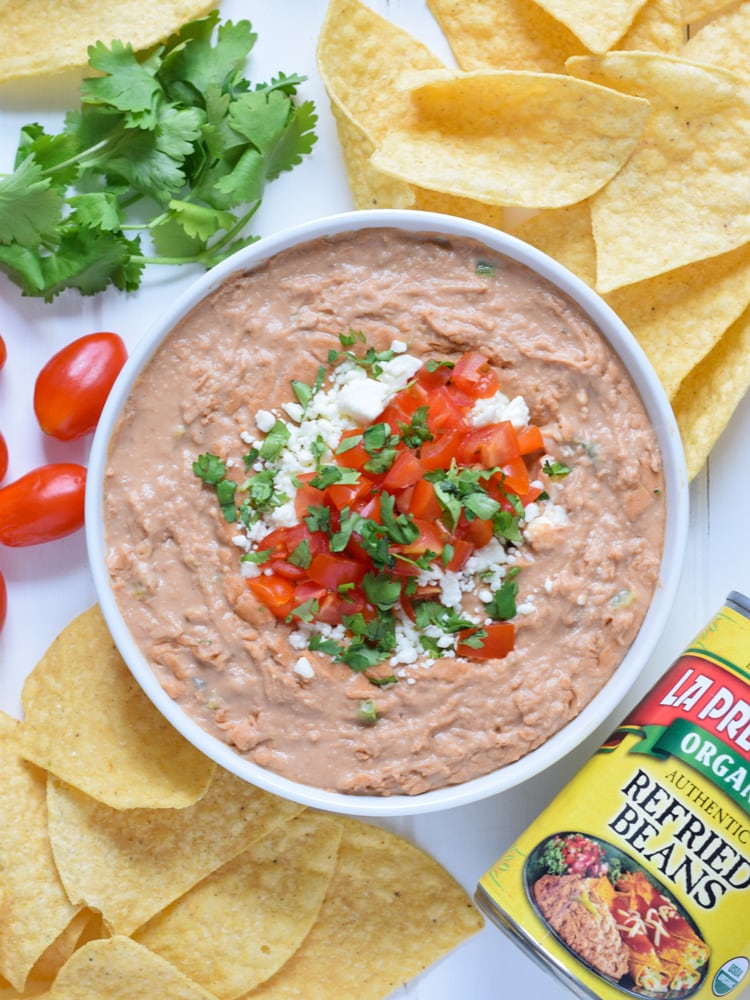 This creamy bean dip recipe is made with cream cheese, Mexican spices and diced jalapenos. It's easy to make and is the perfect appetizer or snack!