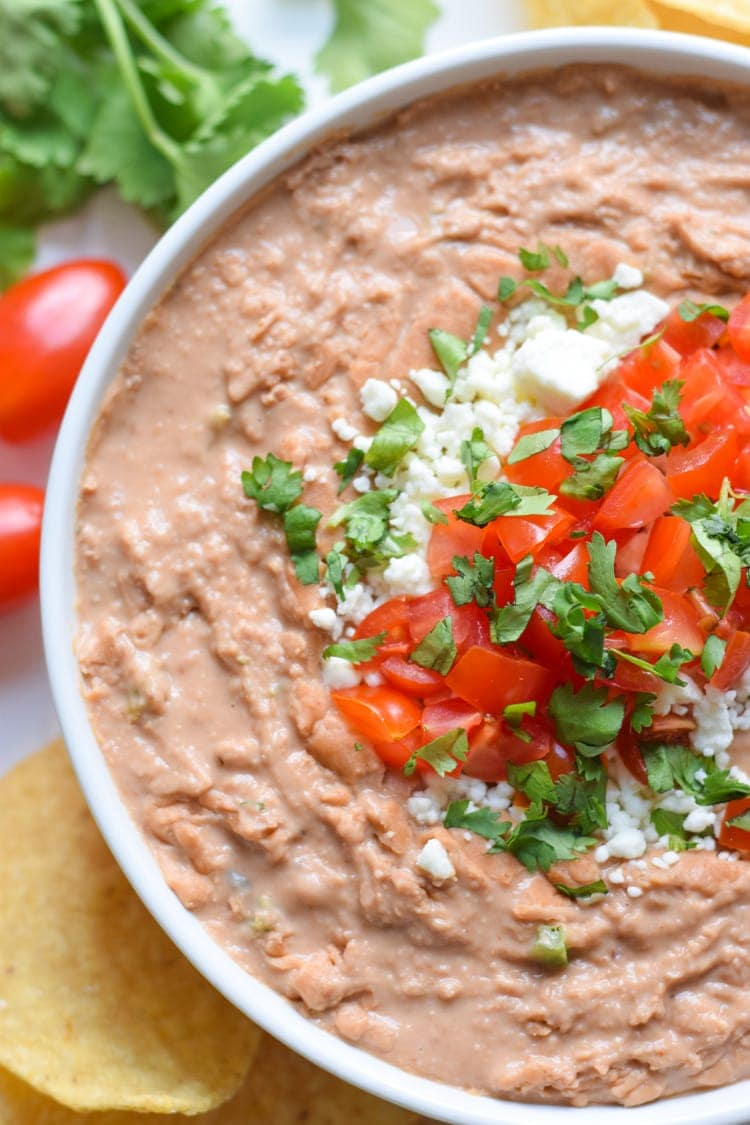 Mixed with cream cheese, Mexican spices and diced jalapenos, this creamy bean dip recipe is easy to make and is the perfect appetizer or snack!