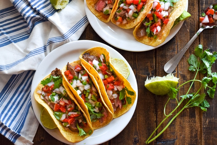 Topped with fresh pico de gallo salsa for an added crunch, these easy-to-make Marinated Flank Steak Tacos are juicy, bright and super flavorful. Perfect for any weeknight meal! (gluten free, dairy free, paleo)