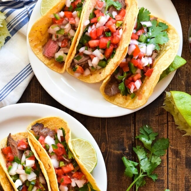 Topped with fresh pico de gallo salsa for an added crunch, these easy-to-make Marinated Flank Steak Cacos are juicy, bright and super flavorful. Perfect for any weeknight meal! (gluten free, dairy free, paleo)