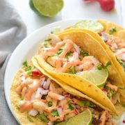 Made with a bright and creamy chipotle lime crema made with greek yogurt and lime juice, these Fish Tacos take only 15 minutes to make and are gluten free!