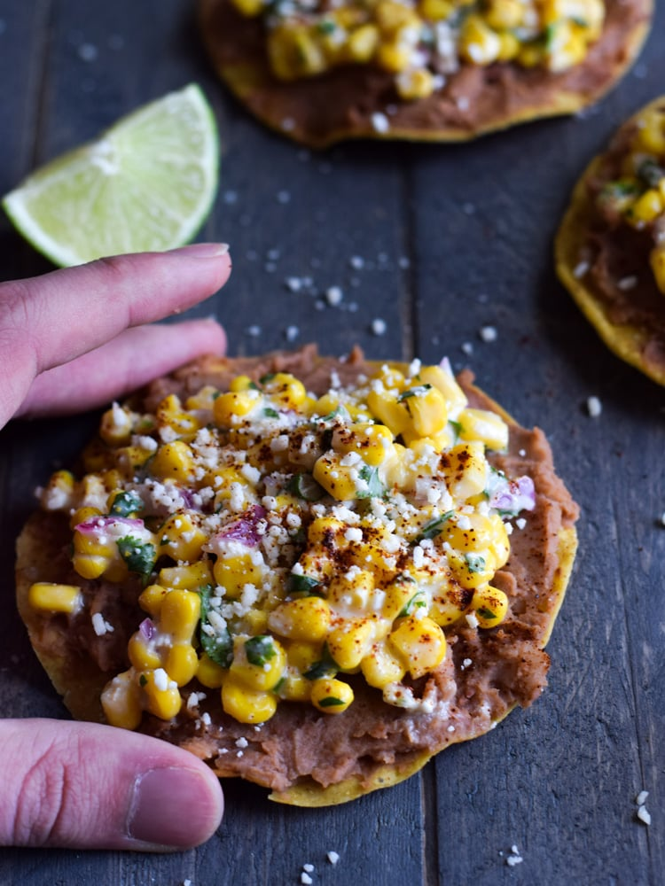 Ready in only 15 minutes, these Mexican Street Corn Tostadas made with canned corn, cotija cheese and chopped cilantro make for an easy lunch or quick dinner that's also gluten free and vegetarian.