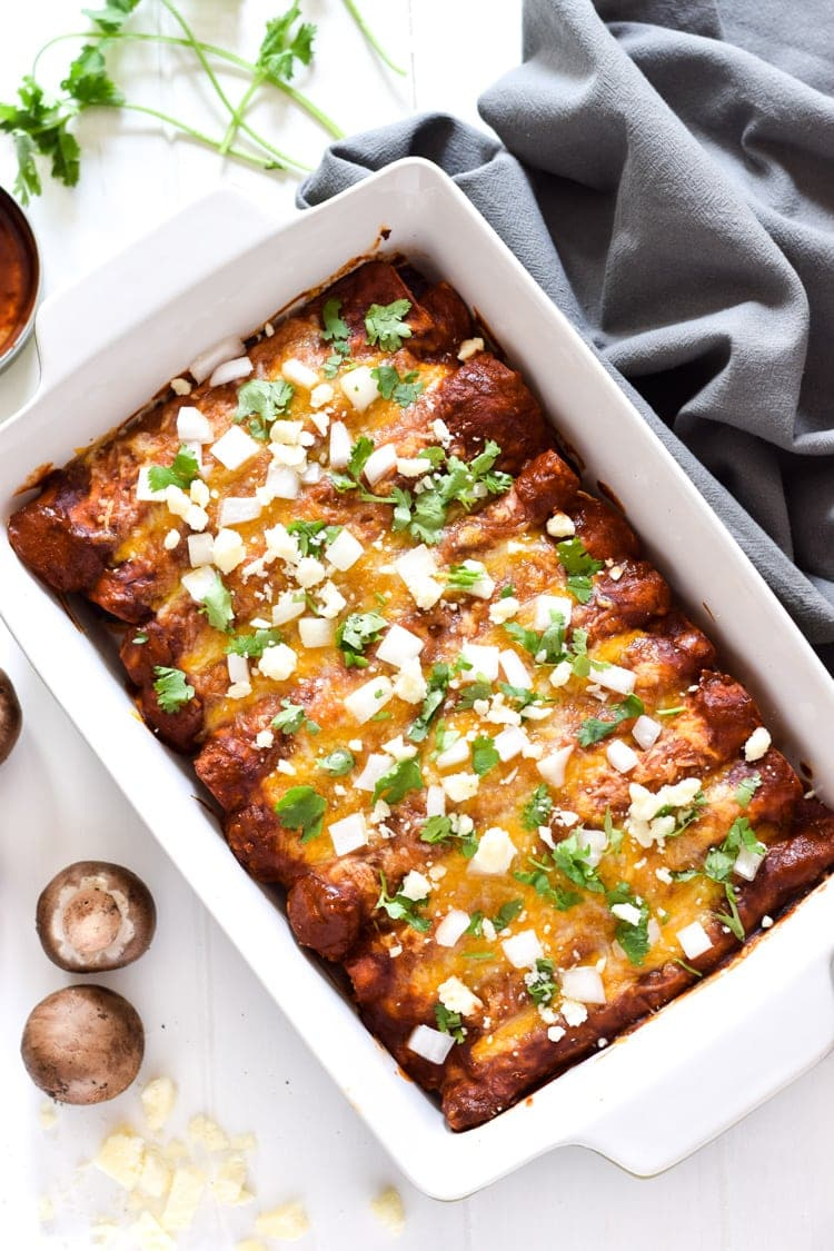 These Spinach Enchiladas are covered in a red enchilada sauce and stuffed with spinach, mushrooms and onions for a tasty Mexican dinner!