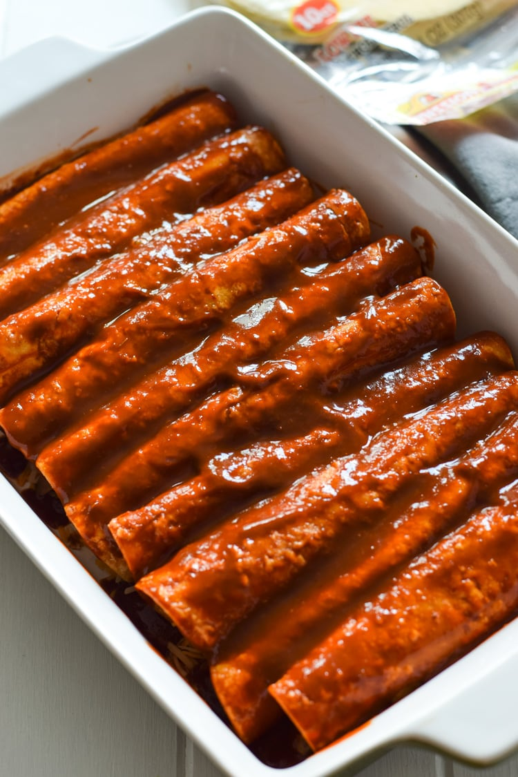 spinach enchiladas topped with enchilada sauce