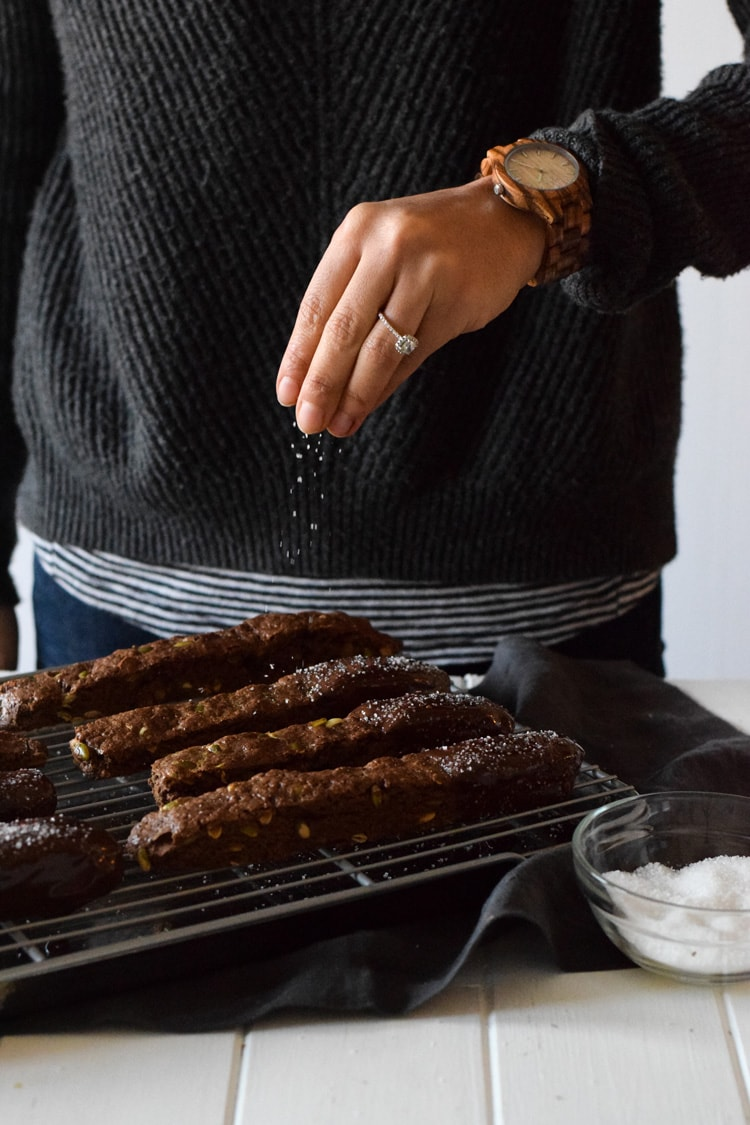 Homemade Mexican Chocolate Pumpkin Seed Biscotti dipped in melted chocolate and sprinkled with sea salt. Holiday perfection. Featuring JORD Wood Watch - Fieldcrest Zebrawood and Maple
