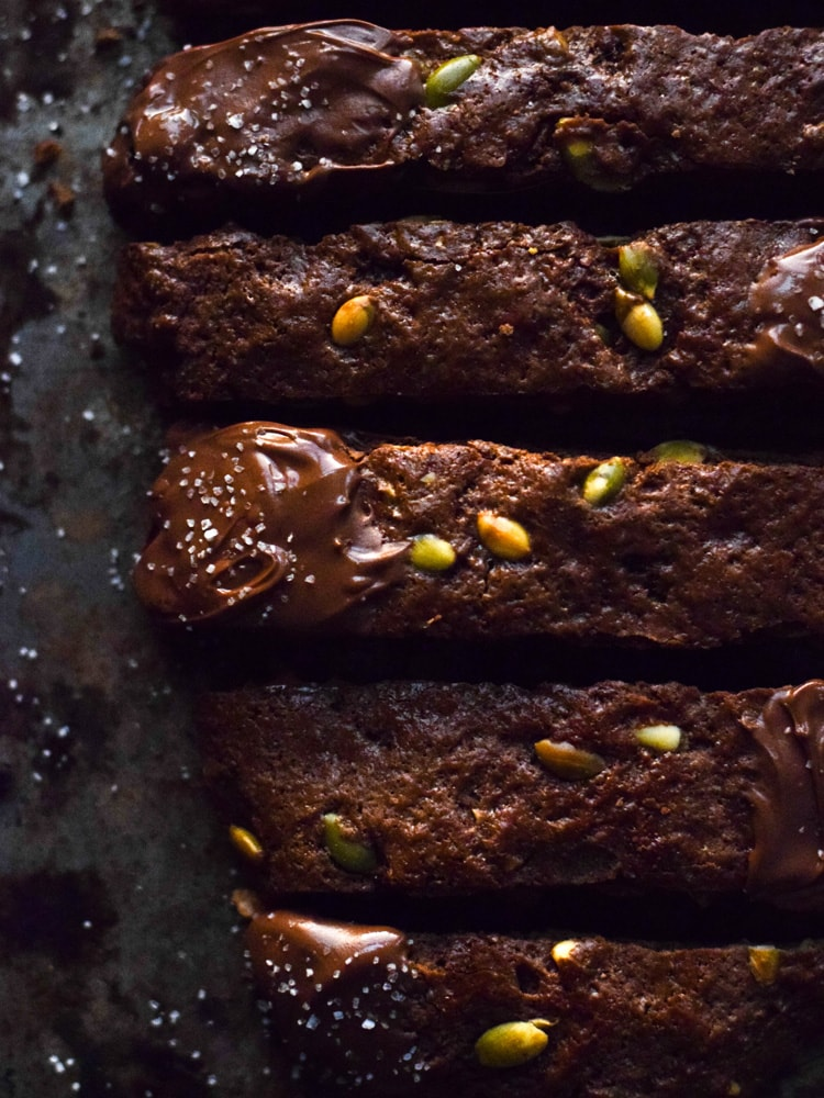 Homemade Mexican Chocolate Pumpkin Seed Biscotti dipped in melted chocolate and sprinkled with sea salt. Holiday perfection.