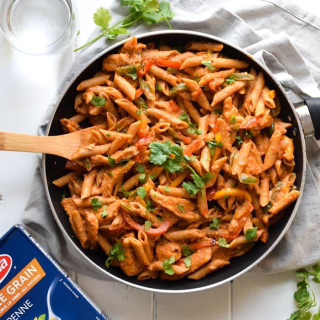 Filled with colorful bell peppers in a light yet creamy chili tomato sauce, this Healthy Chicken Fajita Pasta is perfect for those busy nights when you need to get something delicious yet healthy on the table quickly.