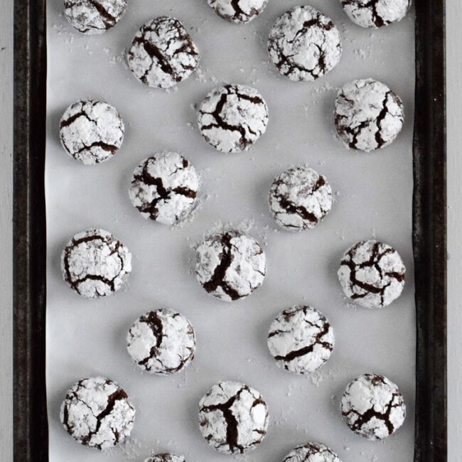 Classic holiday Chocolate Crinkle Cookies with a twist! Made with Abuelita Mexican chocolate, these festive cookies are soft, chewy and covered in powdered sugar.