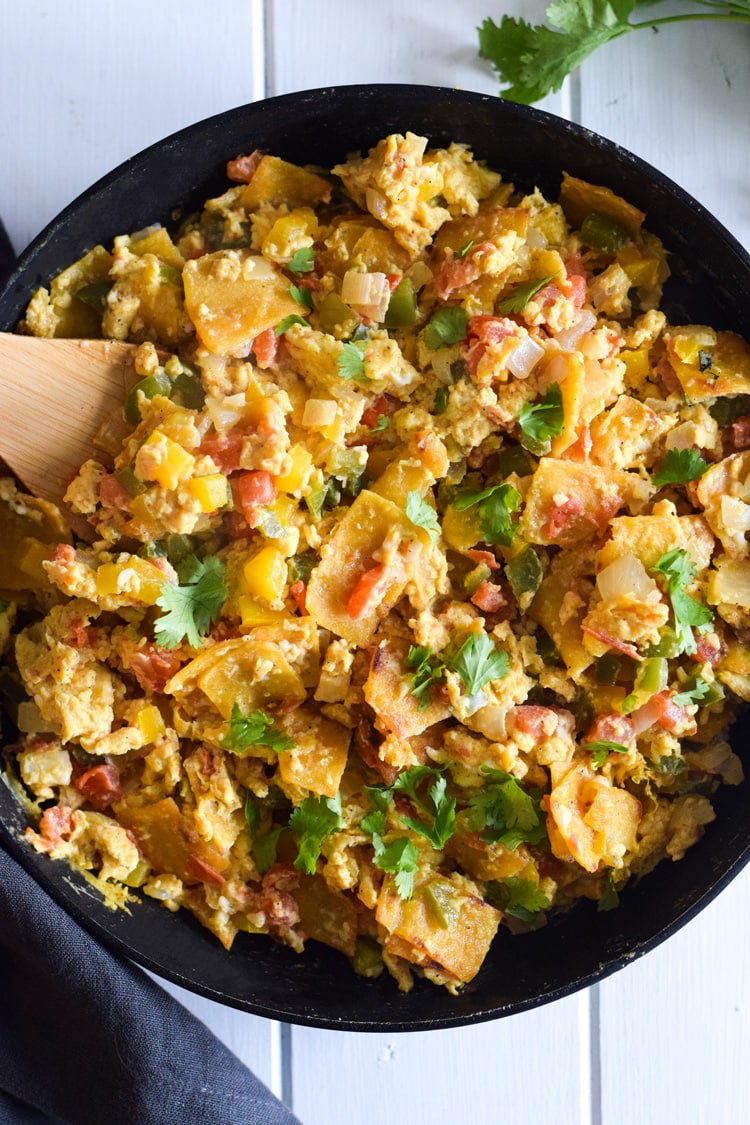 Made with crispy corn tortillas and veggies, Migas (Mexican Egg & Tortilla Breakfast Skillet) is an easy morning meal for the whole family! (gluten free + vegetarian)