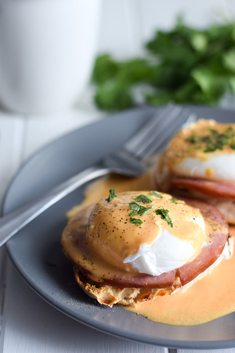 Easy Chipotle Eggs Benedict recipe made with a lightened-up blender chipotle hollandaise sauce. Ready in only 25 minutes and is the perfect brunch!