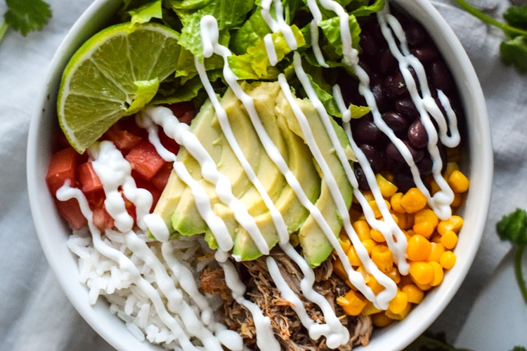 This Healthy Chicken Carnitas Burrito Bowl is easy to make, inexpensive and perfect for meal prep day. Ready in under 20 minutes and is also gluten free.