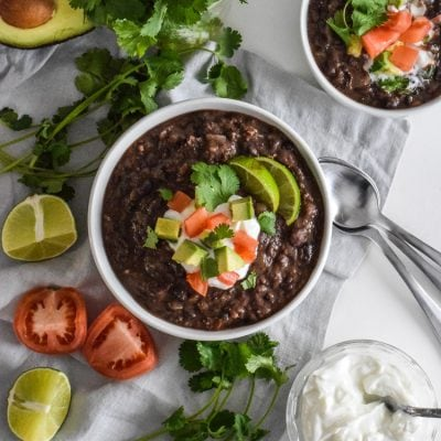 This Spicy Vegetarian Black Bean Soup will warm you up from the inside out. This healthy and easy recipe is gluten free, vegetarian and vegan.