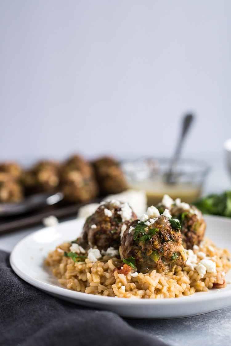 These Mexican Turkey Meatballs made with cilantro, garlic and a packet of taco seasoning are a great appetizer or weeknight meal when served with Arroz Verde (green chile rice).