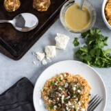 These Mexican Turkey Meatballs made with cilantro, garlic and a packet of taco seasoning are a great appetizer or weeknight meal when served with Arroz Verde.