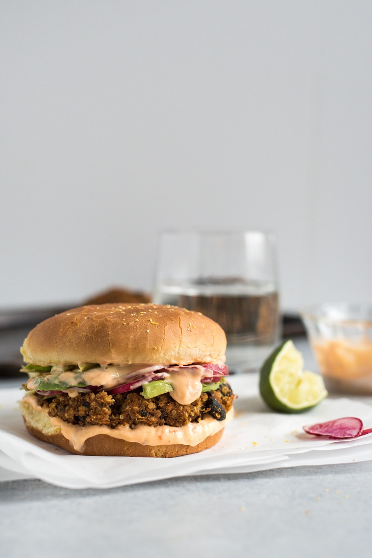 This Sweet Potato Black Bean Burger with Chili Lime Mayo is made with quinoa, sweet potatoes, black beans and spices. No eggs required! It's gluten free, vegetarian and vegan.