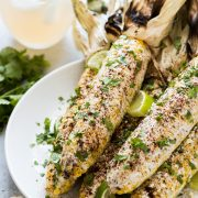 Authentic Mexican Street Corn on the cob covered in creamy mayo and topped with cilantro, lime juice, Cotija cheese and chili powder is the perfect Mexican summer side dish!