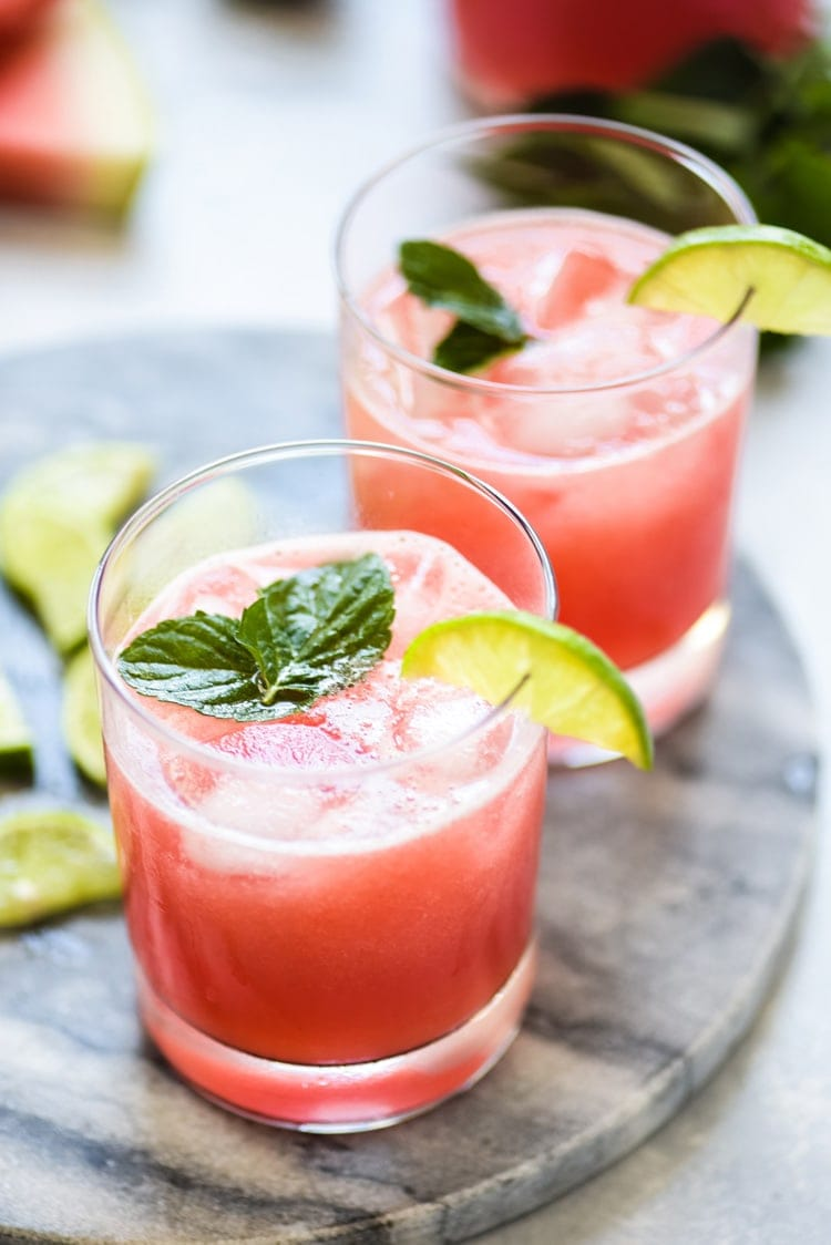 Agua de Sandia (also known as watermelon agua fresca) in a glass filled with ice.
