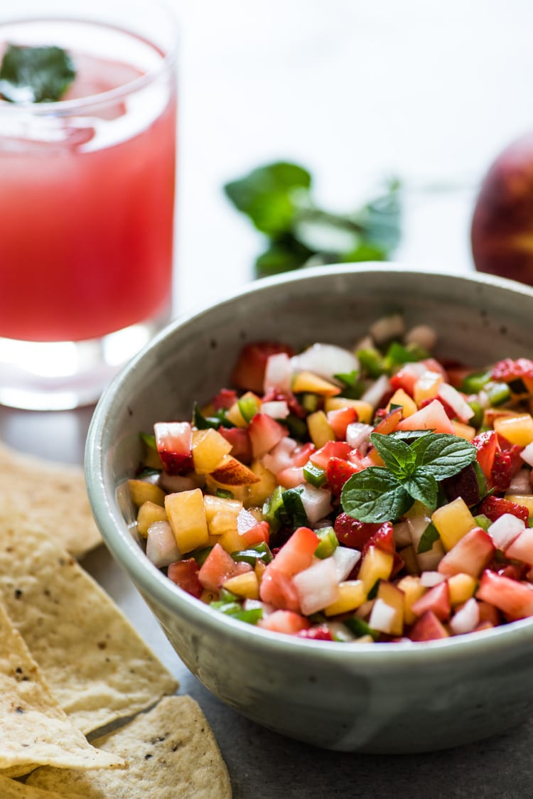 This Peach Strawberry Salsa is super fresh, sweet yet savory and tastes great with chips and salsa. Also makes a great topping for tacos, salads and grilled meats!