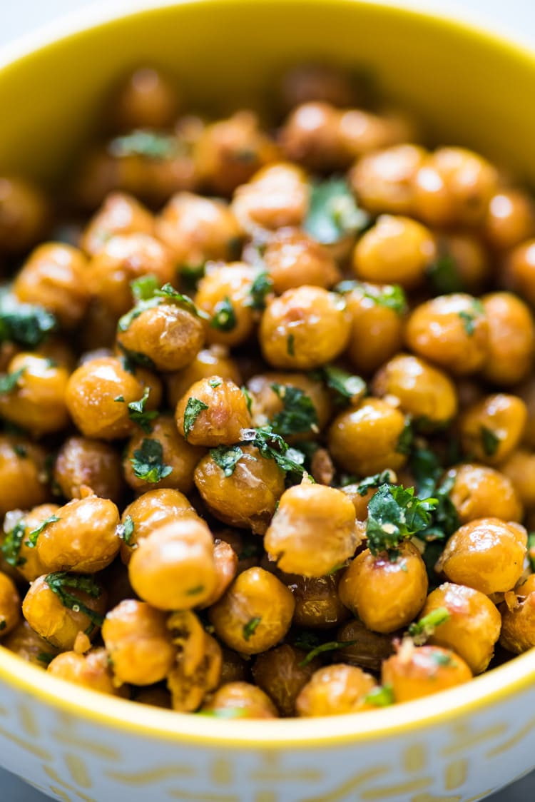 These Cilantro Lime Roasted Chickpeas are a healthy and addicting salty snack with plenty of crunch to satisfy your snack cravings! (gluten free, vegetarian, vegan)