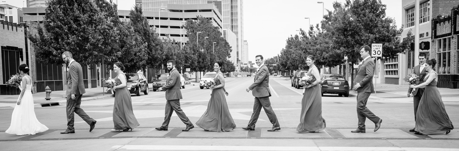 Wedding party walking in Film Row in Oklahoma City // Photo by Leia Smethurst