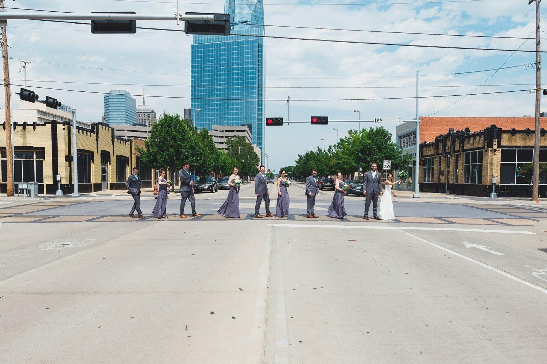 Wedding party walking in Film Row in Oklahoma City // Photo by Leia Smethurst