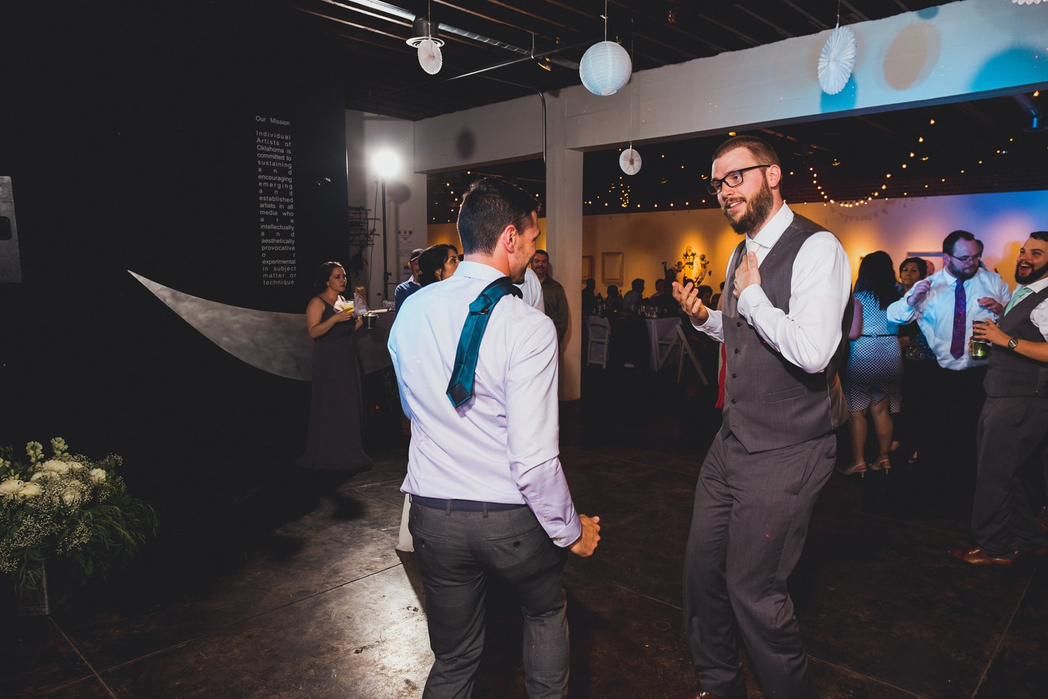 DJ Connection dancing at John Moore and Isabel Orozco Moore wedding at IAO Gallery in Oklahoma City // Photo by Leia Smethurst Photography