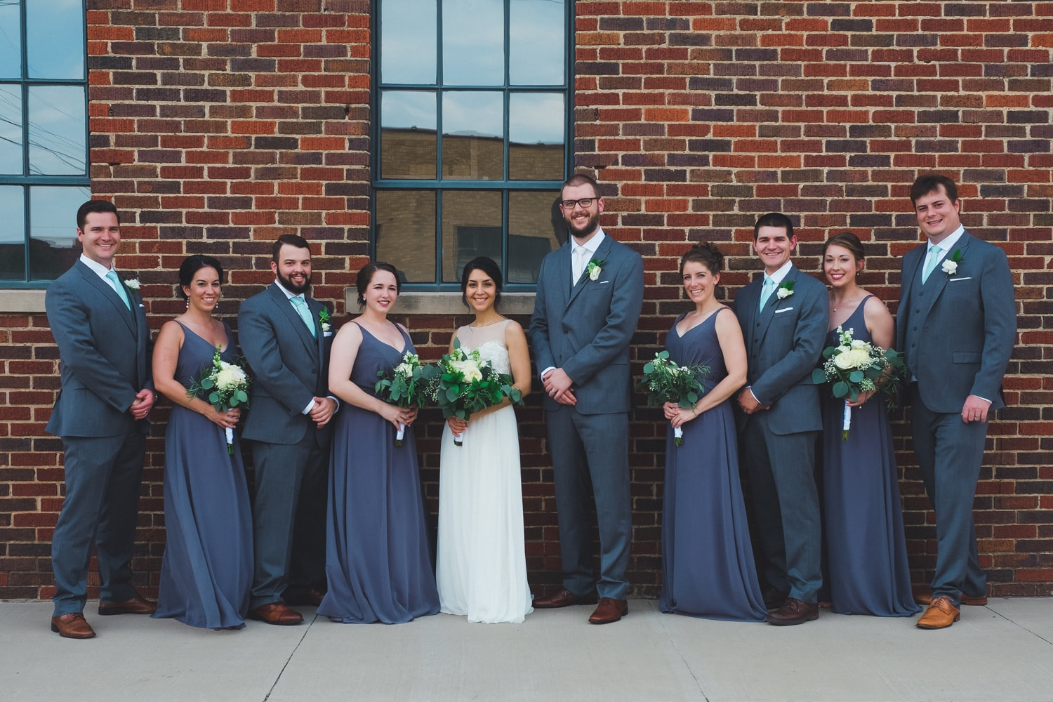 Isabel Orozco Moore and John Moore wedding party in Film Row in Oklahoma City // Photo by Leia Smethurst