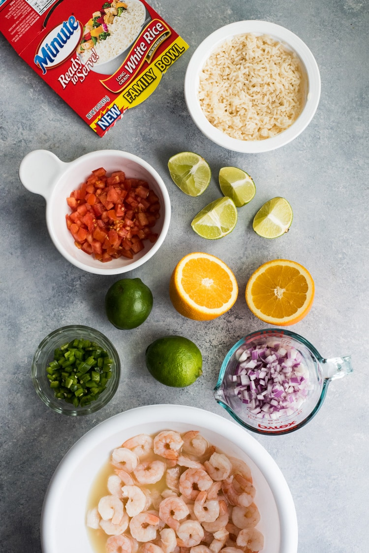 This easy, light and refreshing Mexican Ceviche Rice Bowl is the perfect summer meal made from citrus marinated shrimp, tomatoes, onions, jalapenos and cilantro.