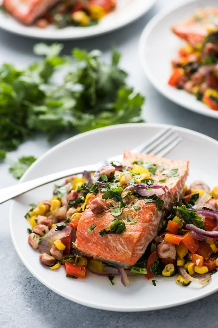 This Roasted Adobo Salmon with Rainbow Vegetable Stir Fry is packed with tons of protein and veggies that's perfect for any weeknight meal! (gluten free)