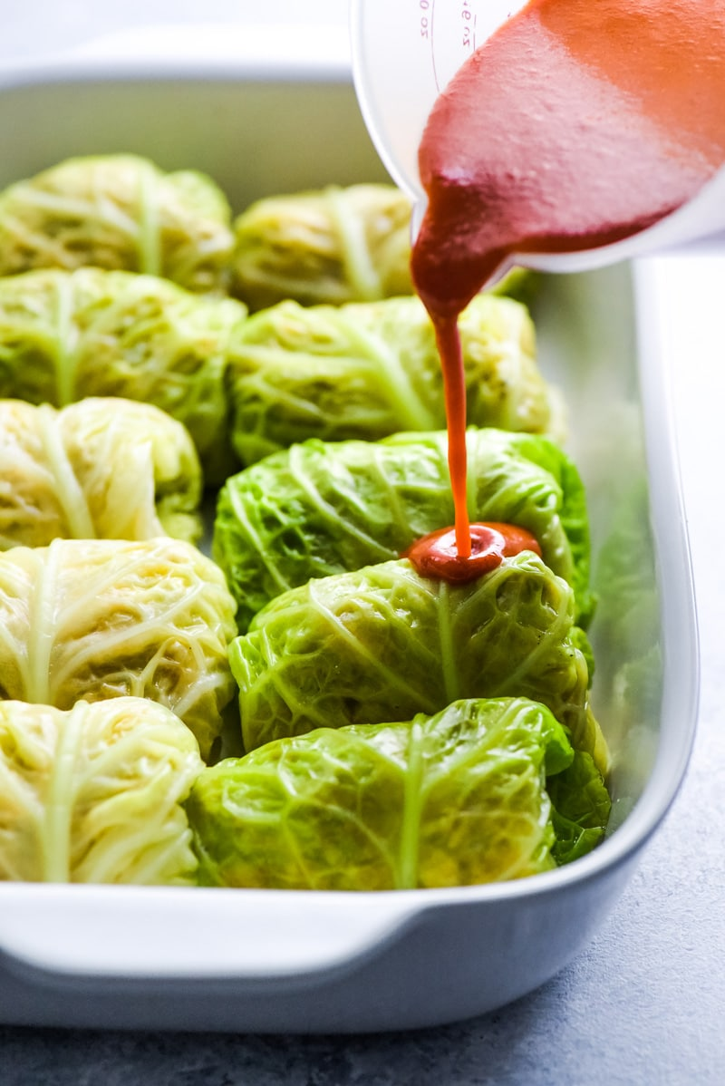 These Low Carb Enchilada Cabbage Rolls are made with cabbage leaves and stuffed with chicken, cheese and green chiles for a healthy weeknight meal!