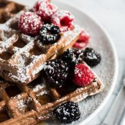 Made with a hint of cinnamon and adobo chili powder, these Chili Chocolate Waffles topped with fresh berries, powdered sugar and maple syrup are a brunch delight!