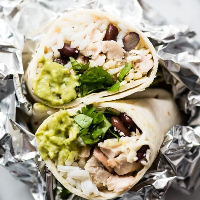 These Roasted Poblano Chicken Burritos are an easy Mexican lunch or dinner recipe that's perfect for weekend meal prep. They're also freezer friendly!