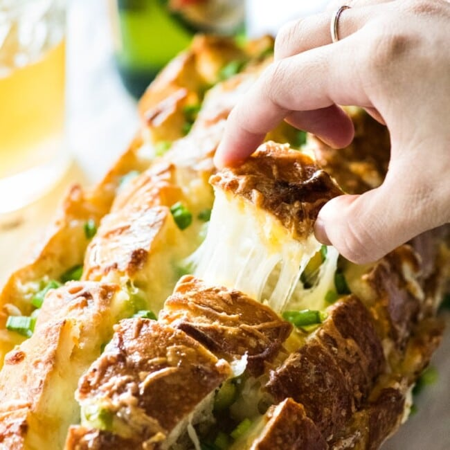 Cheesy, spicy and fun to eat, this Jalapeno Popper Pull Apart Bread is the perfect game day appetizer that's easy to make and ready in 35 minutes!