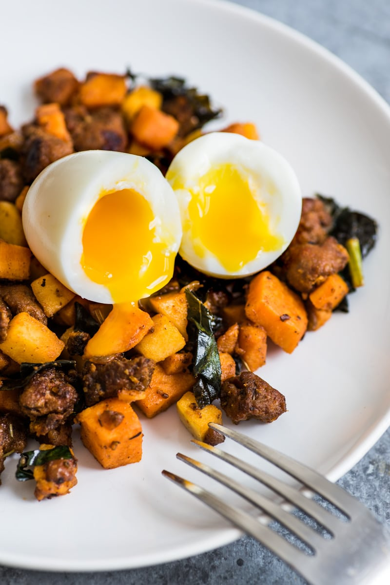 This Mexican Chorizo Sweet Potato Hash with Soft Boiled Eggs is a healthy, filling and comforting meal made with sweet potatoes, Mexican chorizo, kale and Granny Smith apples. It's also gluten free and paleo friendly.